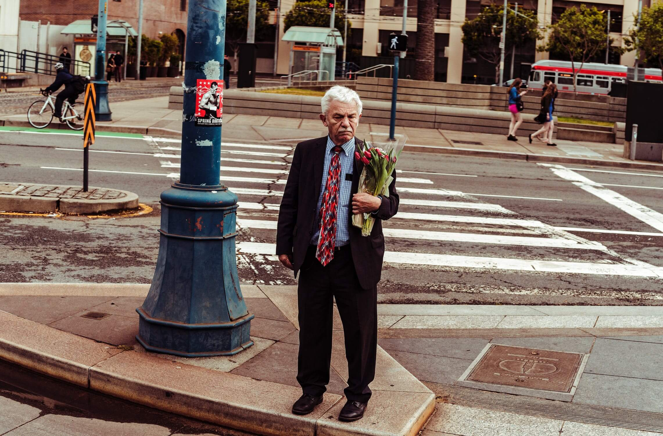 An older crossing the street to visit his wife at a senior living facility