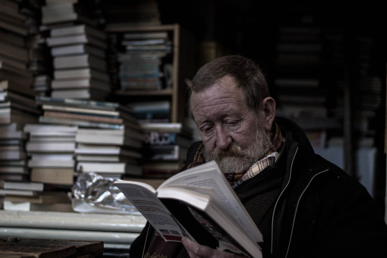 An older man reading about financial planning for seniors.