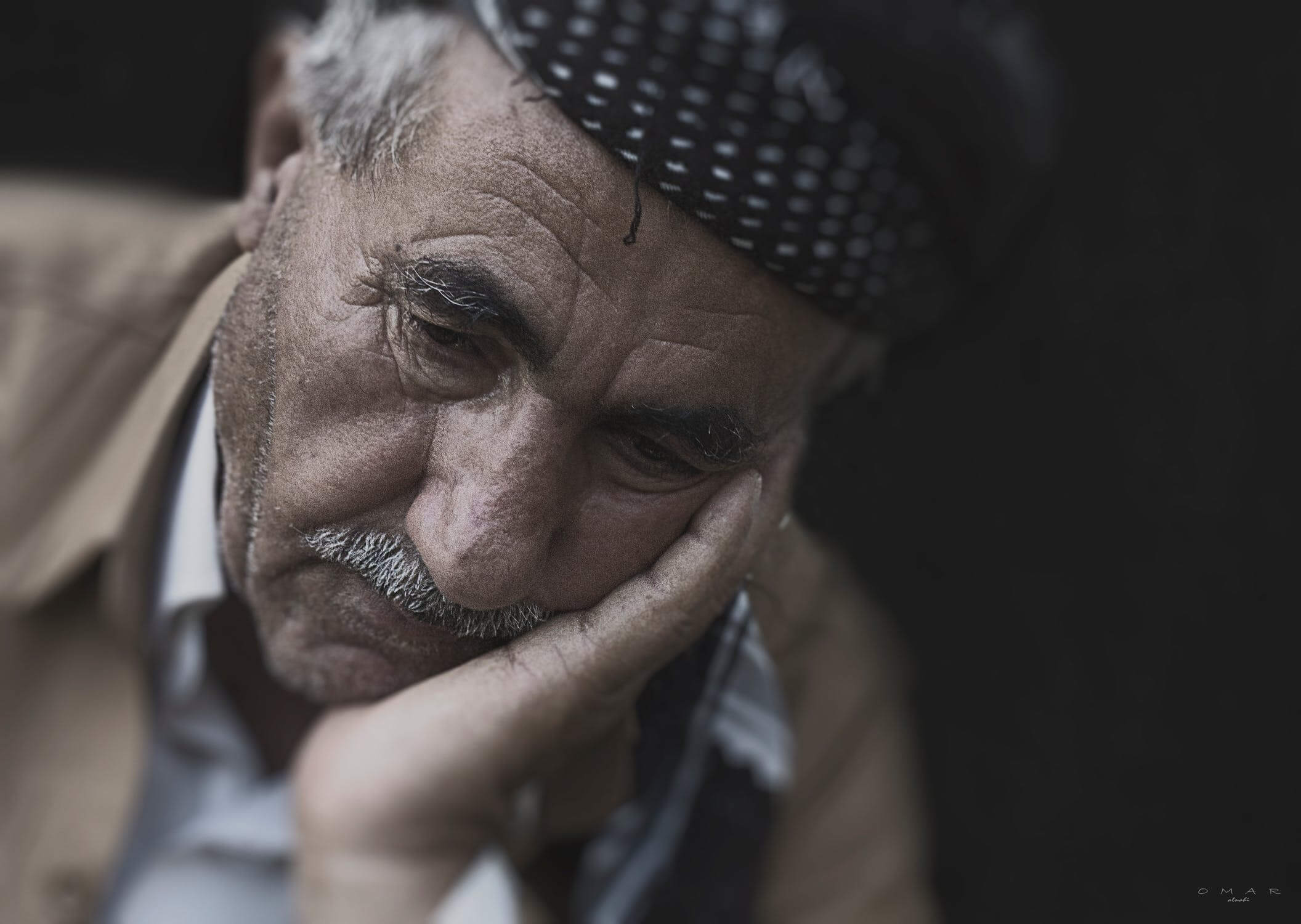 An older man that is sad. He is sad because he has not found the ideal senior living facility yet.
