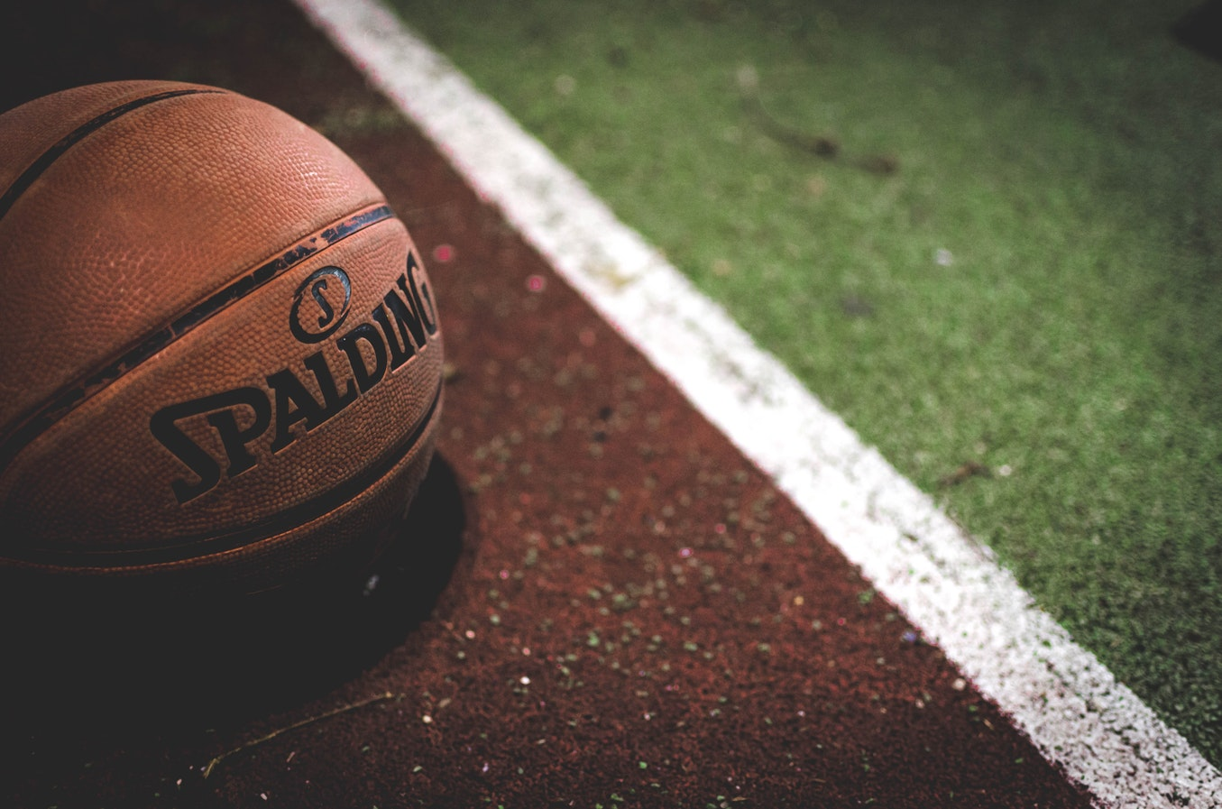 A basketball on the basketball court. The benefits of the outdoors for seniors are very high.