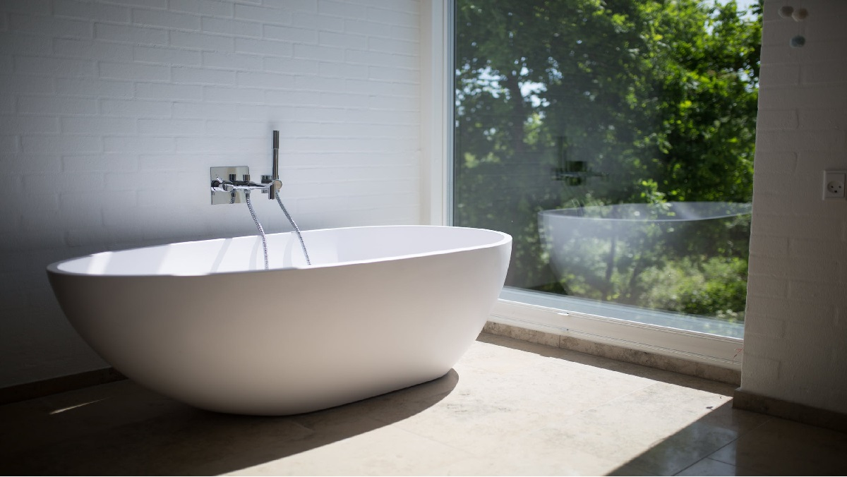 A bathtub overlooking greenery-Technological advancements in bathrooms are helping to keep seniors safe.