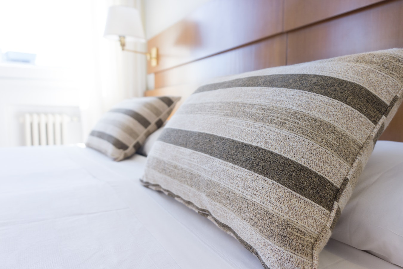 A bed in a hotel room. Healthy sleep habits are crucial to keeping the immune system strong