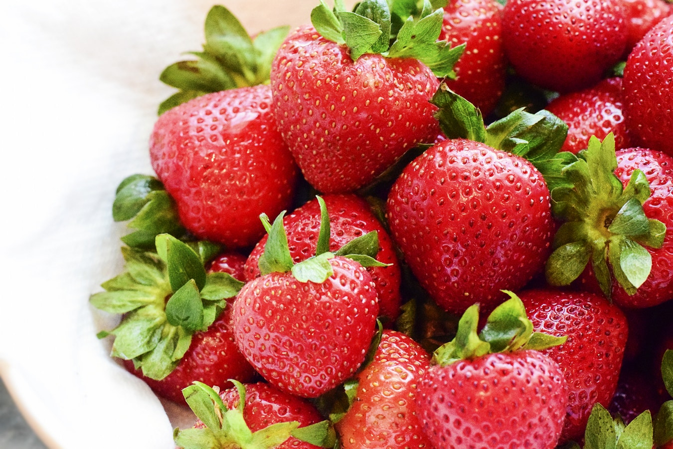A bowl of fresh strawberries. Strawberries are a great source of Vitamin C for seniors