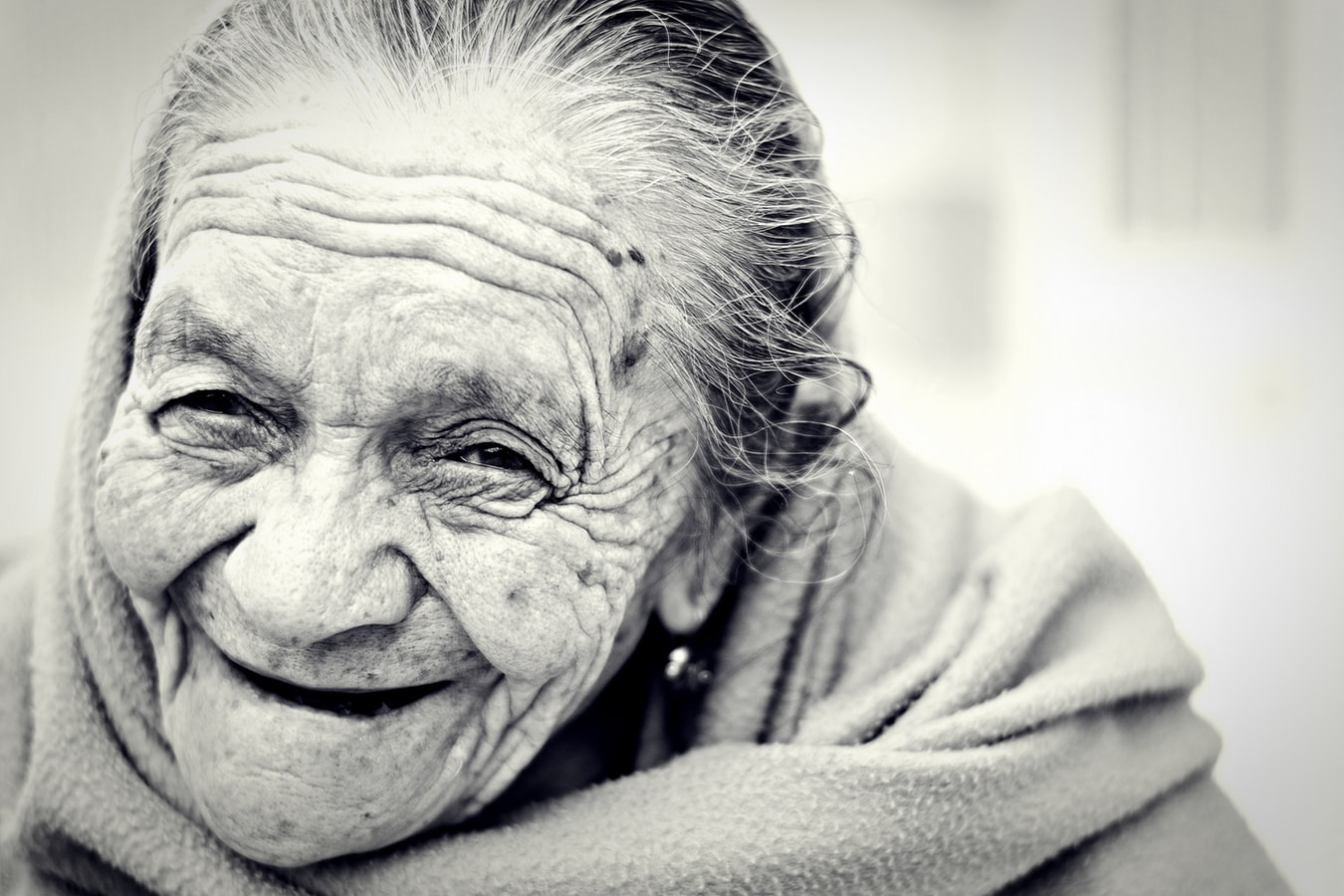 A close up photo of an ederly woman. Preventing eyesight loss in seniors is important as they age