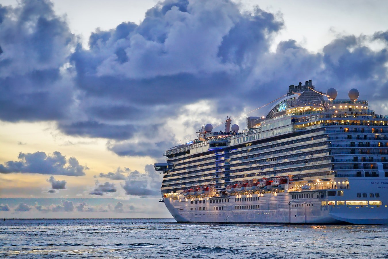 A cruise ship out at sunset on the water that accommodates seniors and older individuals looking for fun