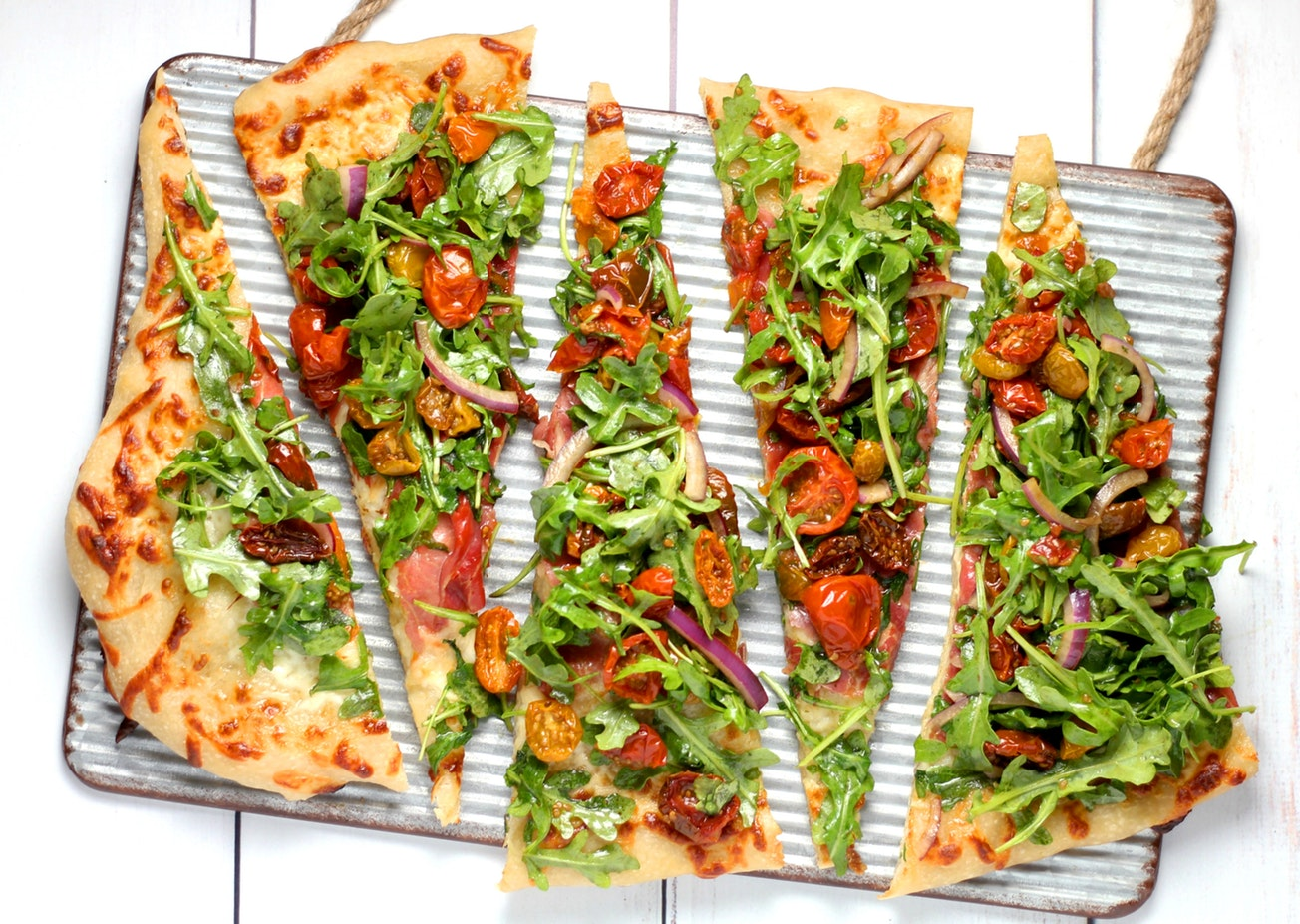 A flatbread with arugula. Arugula is a great food for seniors.