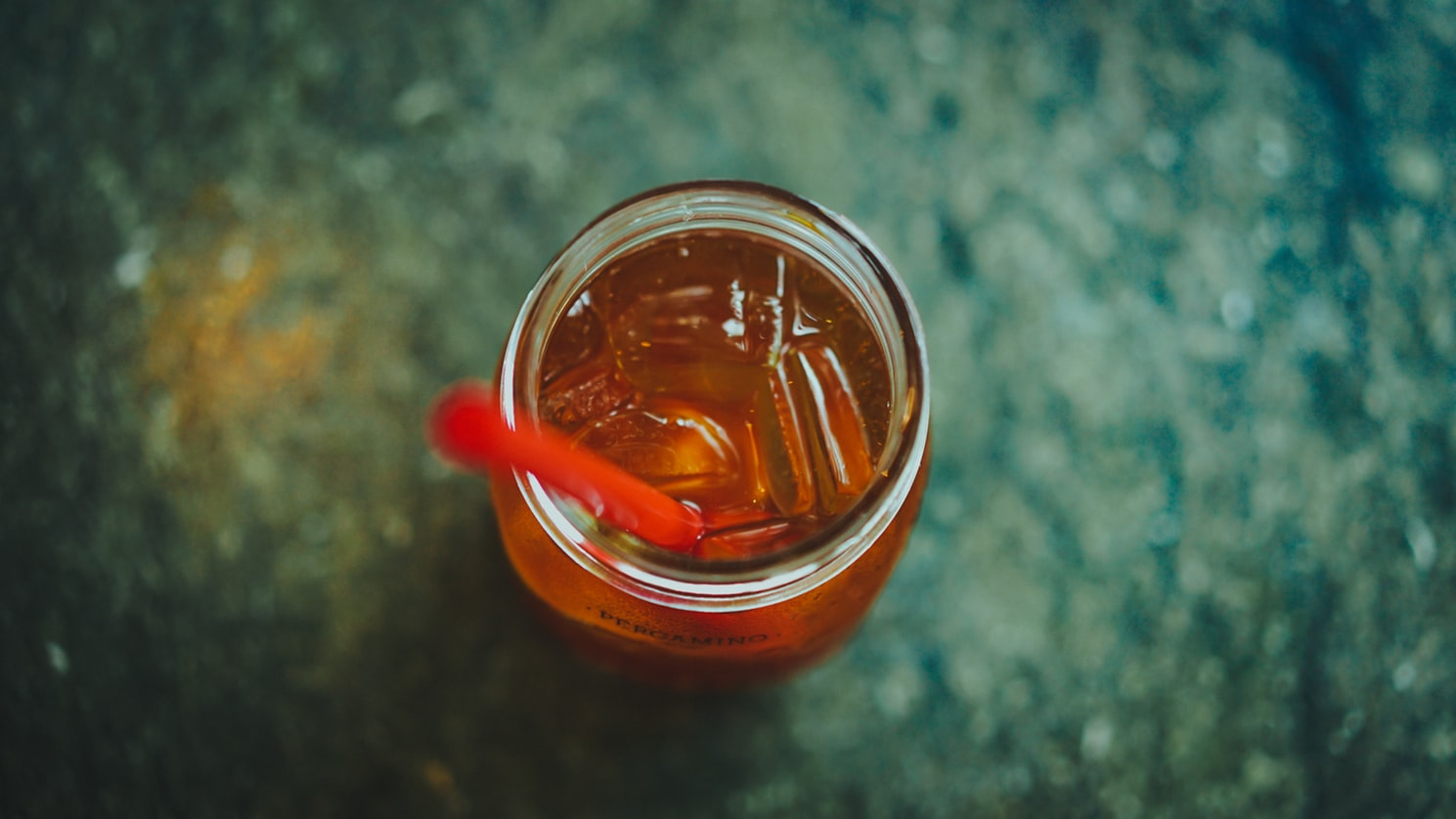A glass of alcohol with a red straw in it. Alcohol use is on the rise in seniors.