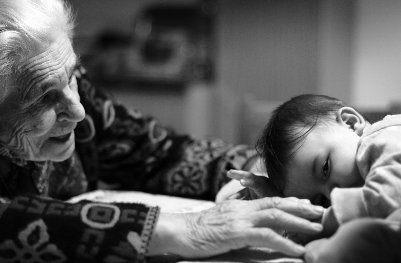 A grandma playing with her grandson. Basic interaction is a great communication strategy for dementia care.