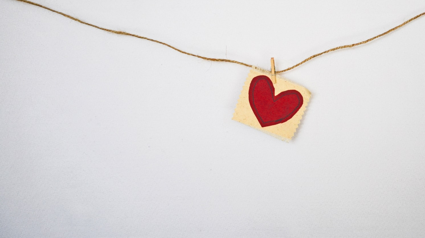 A heart sewn onto a piece of fabric.