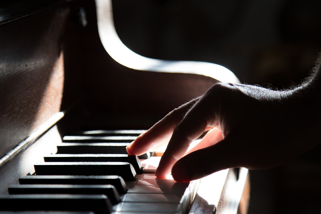 A man playing the piano. Research is starting to show that music therapy is beneficial for alzheimers.
