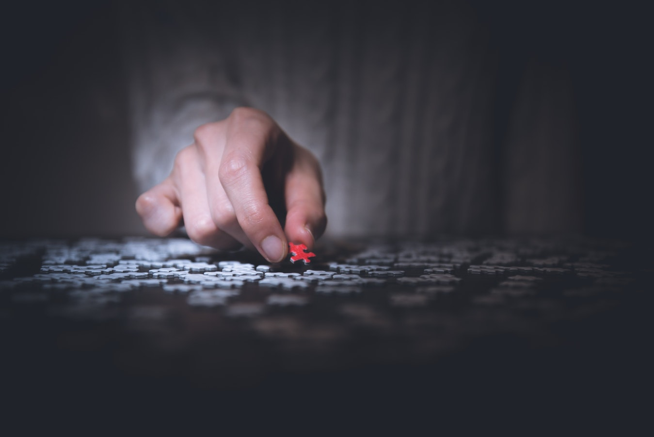 A man working on a puzzle. Puzzles are a great acitivity for people with mobility problems.