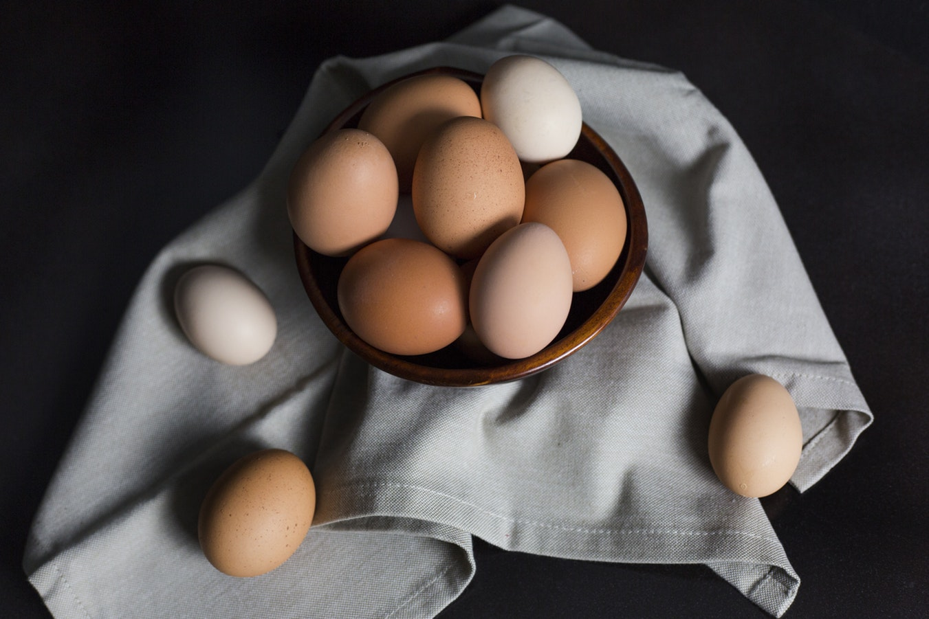 A mixture of brown and white eggs. Eggs are a great source of Vitamin K