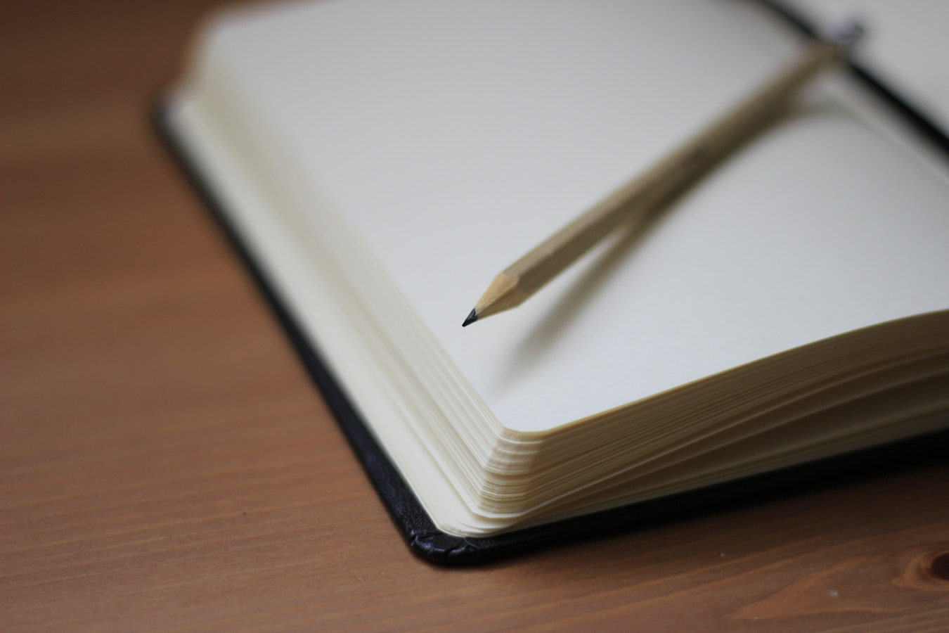 A notepad with a pencil on the open pages. Taking notes is one of the best communication strategies for dementia care.