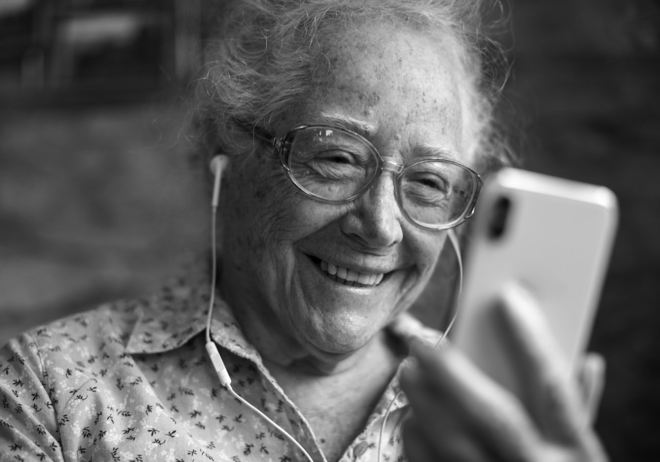 A older woman contacting a friend via video call. Many non-driving seniors in assisted living facilities are using more technology.