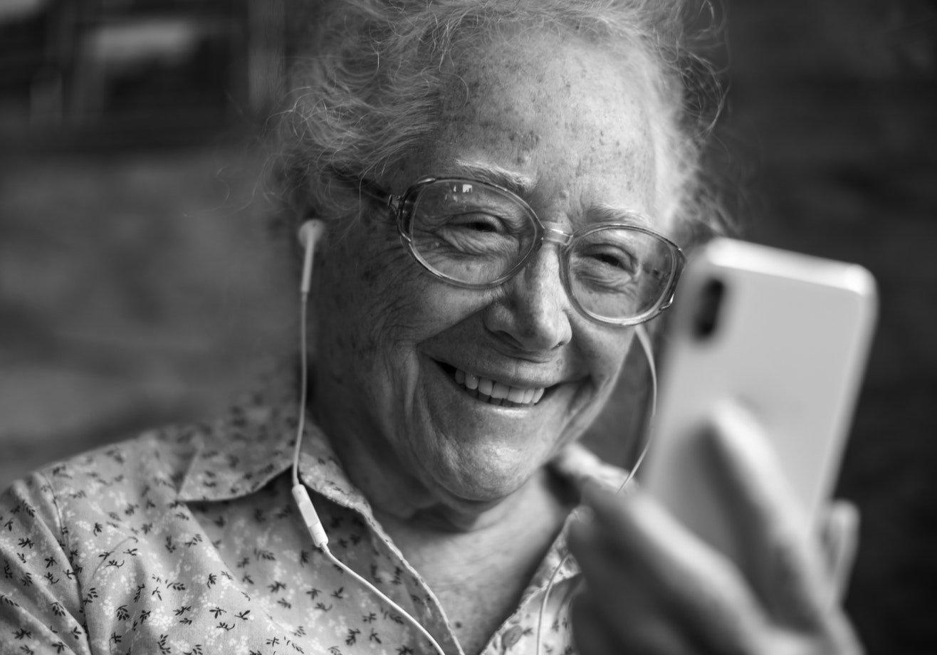 A older woman contacting a friend via video call
