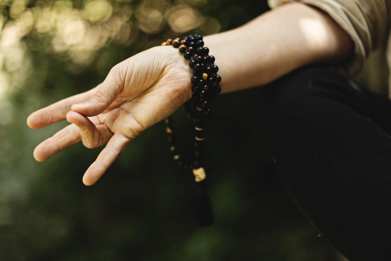 A woman holding a pose perfect for meditation. Meditation can improve well-being for seniors.