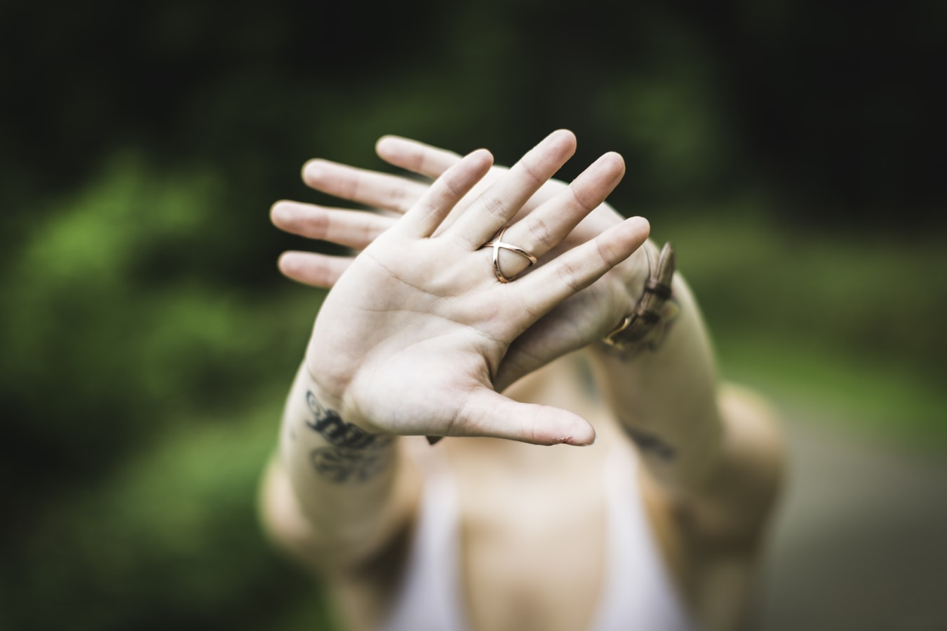 A woman holding her hands out because she wants to prevent prescription medication abuse