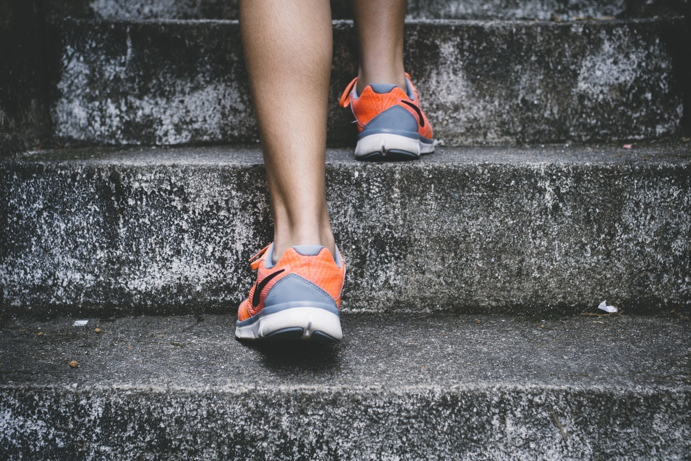 A woman walking up the stairs. Exercise is a great way to help avoid caregiver fatigue.