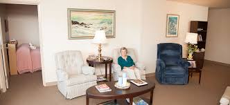 Elderly lady sitting in her senior living apartment