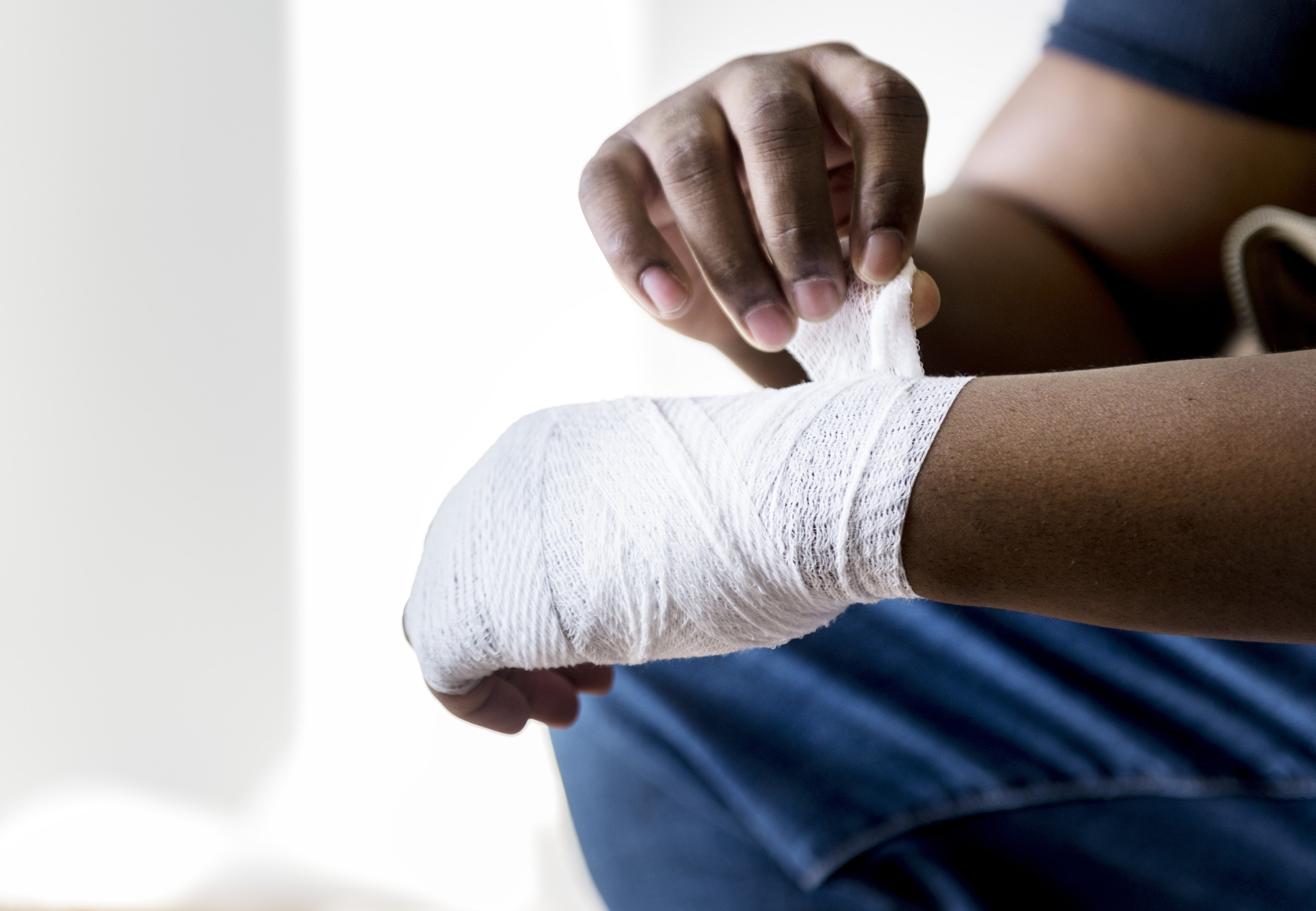 An individual wrapping his hand after sustaining an injury