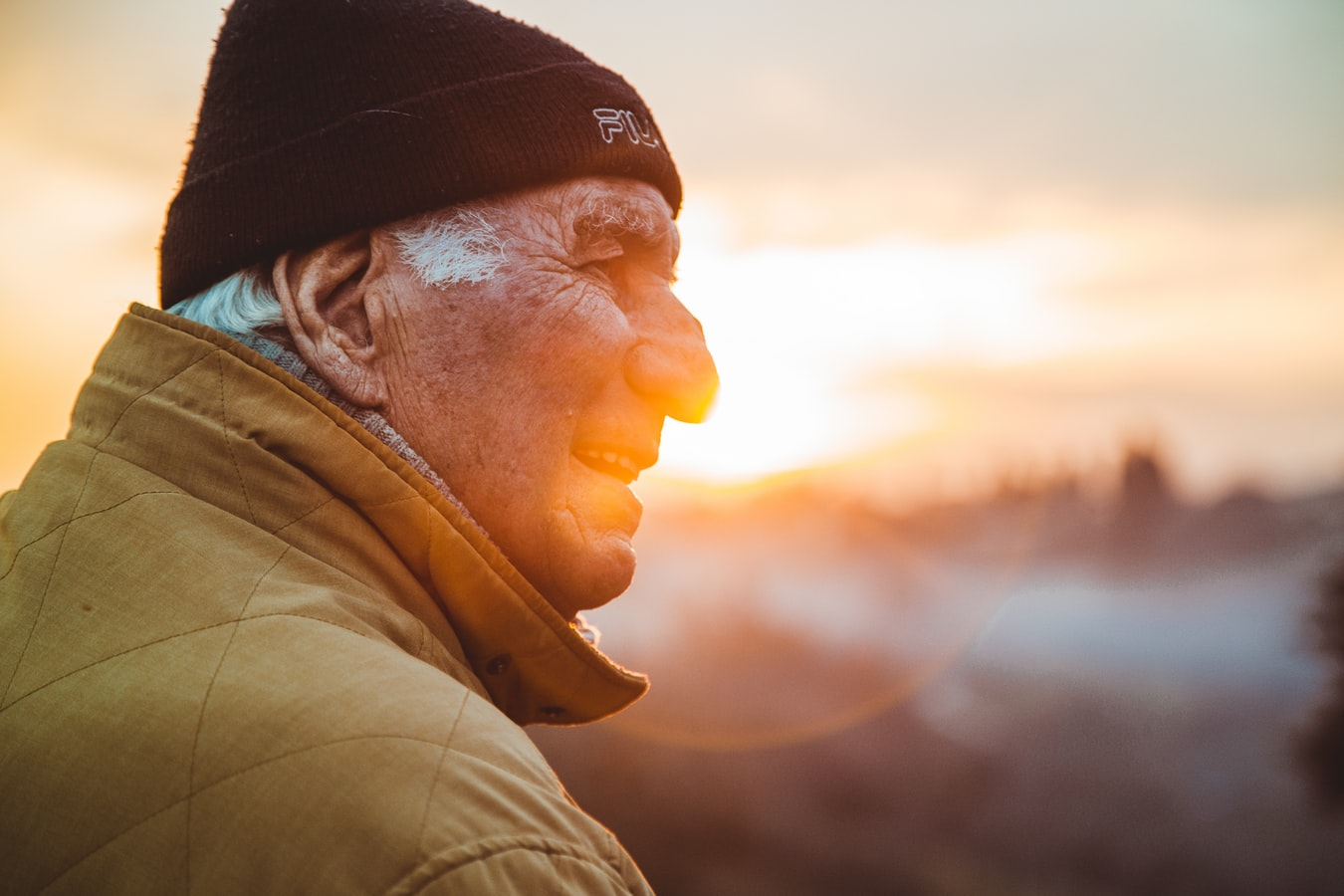 An older man watching the sunset. Many seniors with alzheimers might suffer from sundowning.