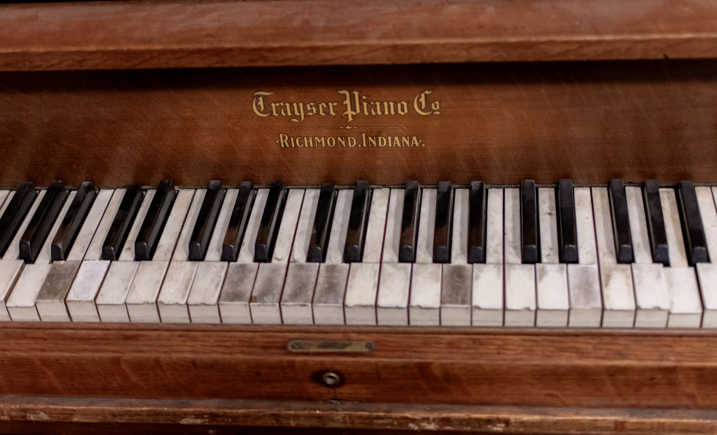 An older piano. An ideal assisted living facility would offer activities like piano playing for residents.