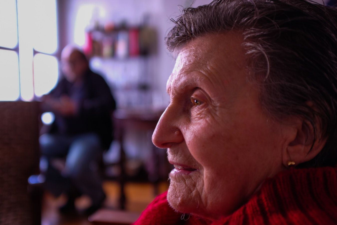 An older woman confused about where she is. Confusion is one of the stages of dementia.
