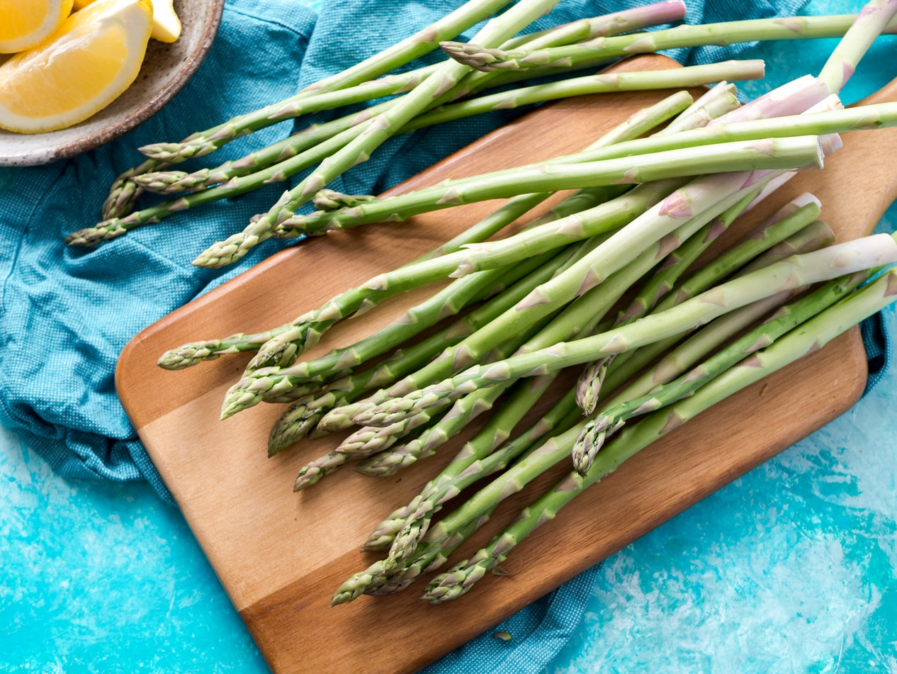 Asparagus on a cutting board. Asparagus is one of the best foods for seniors.
