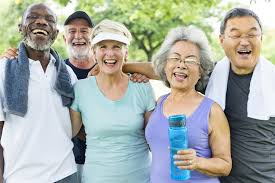 Group of seniors laughing after exercising.