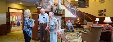 Two seniors taking a tour of their senior living apartment