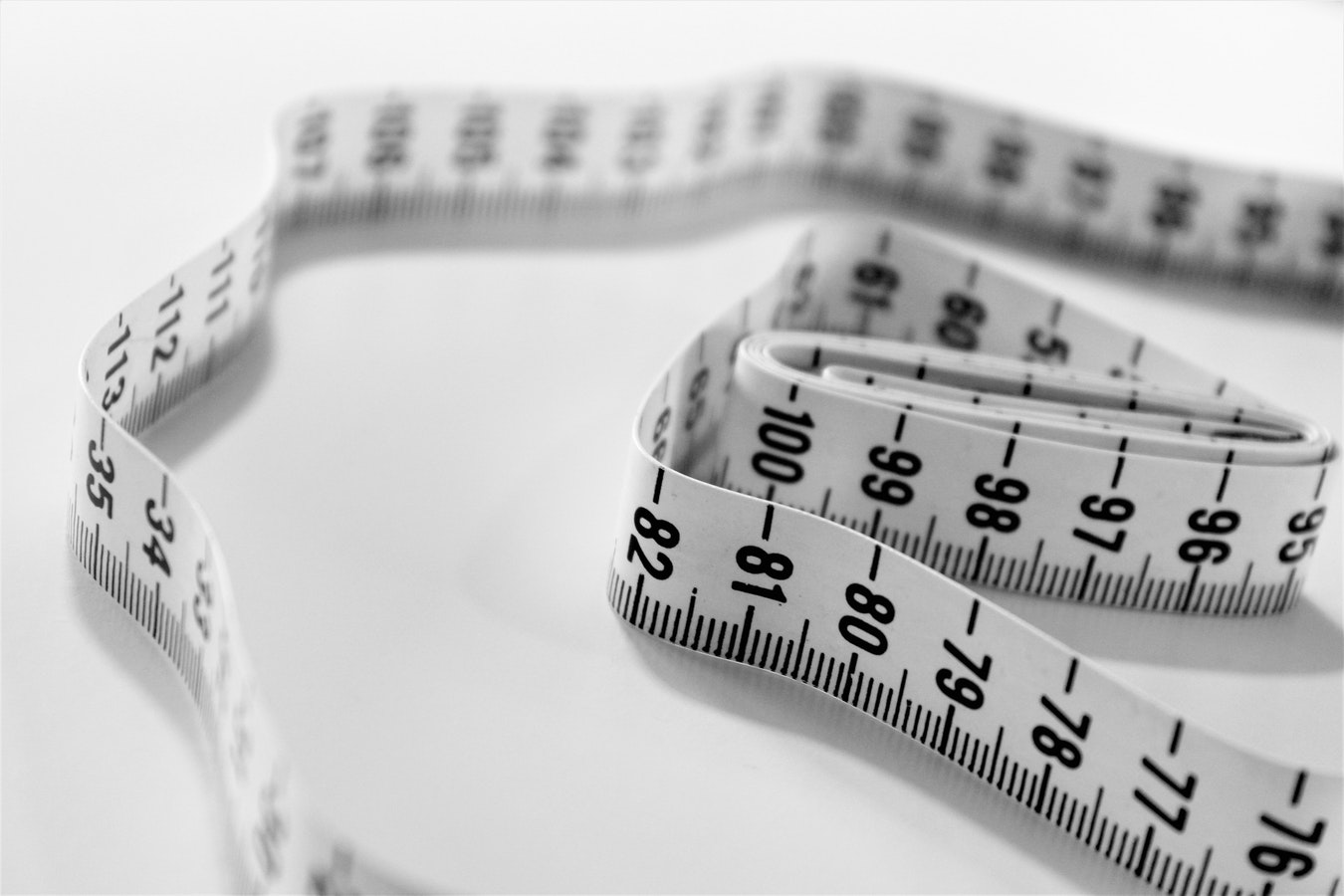 Measuring tape. Obesity is one of the 10 common senior health issues.