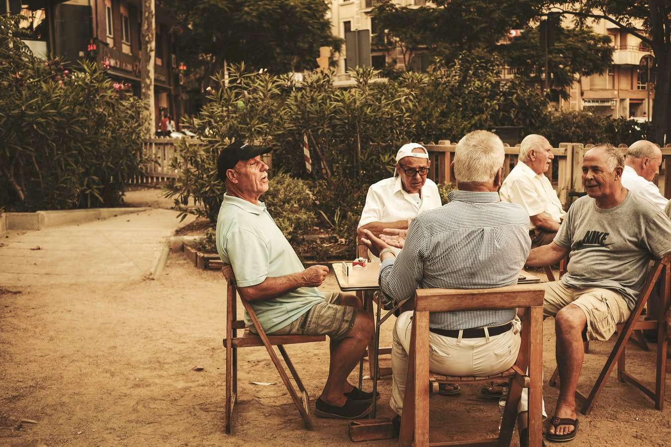 Men sitting outside of their respite care facility enjoying nice conversation