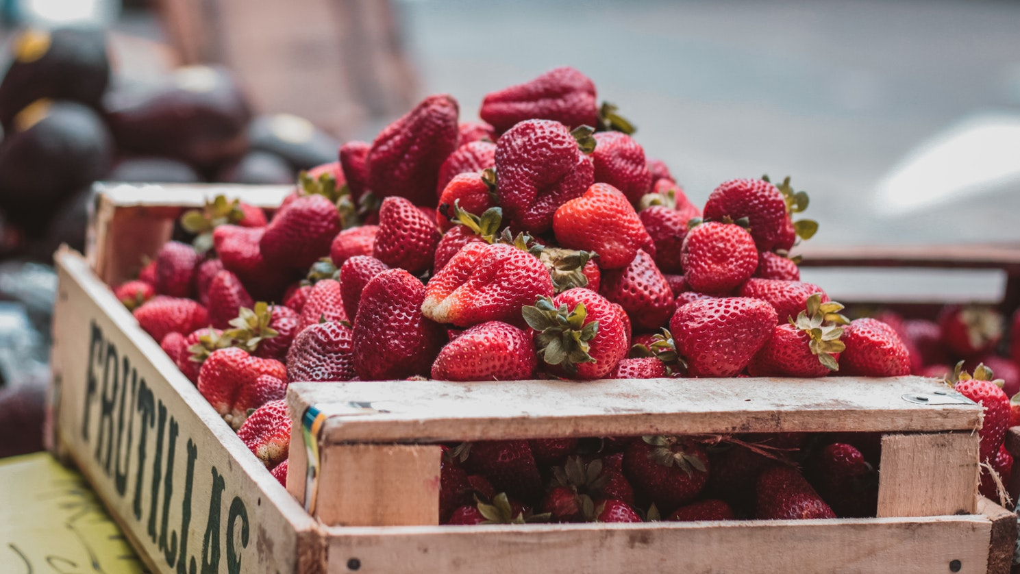 Strawberries at the farmers market; they are some of the best foods for seniors.