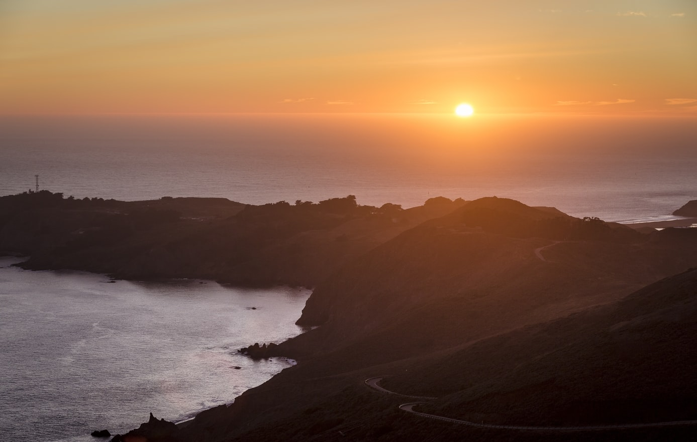 The sun setting over the hills and ocean. Sundowning can occur to individuals who suffer from alzheimers