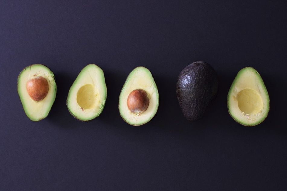 Whole and cut open avacados. Avacados are a source of healthy fats for seniors with diabetes.-1