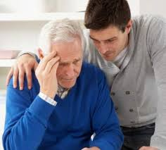 Younger man consoling his elderly father