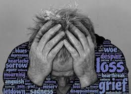 An elderly man grieving over a loss.