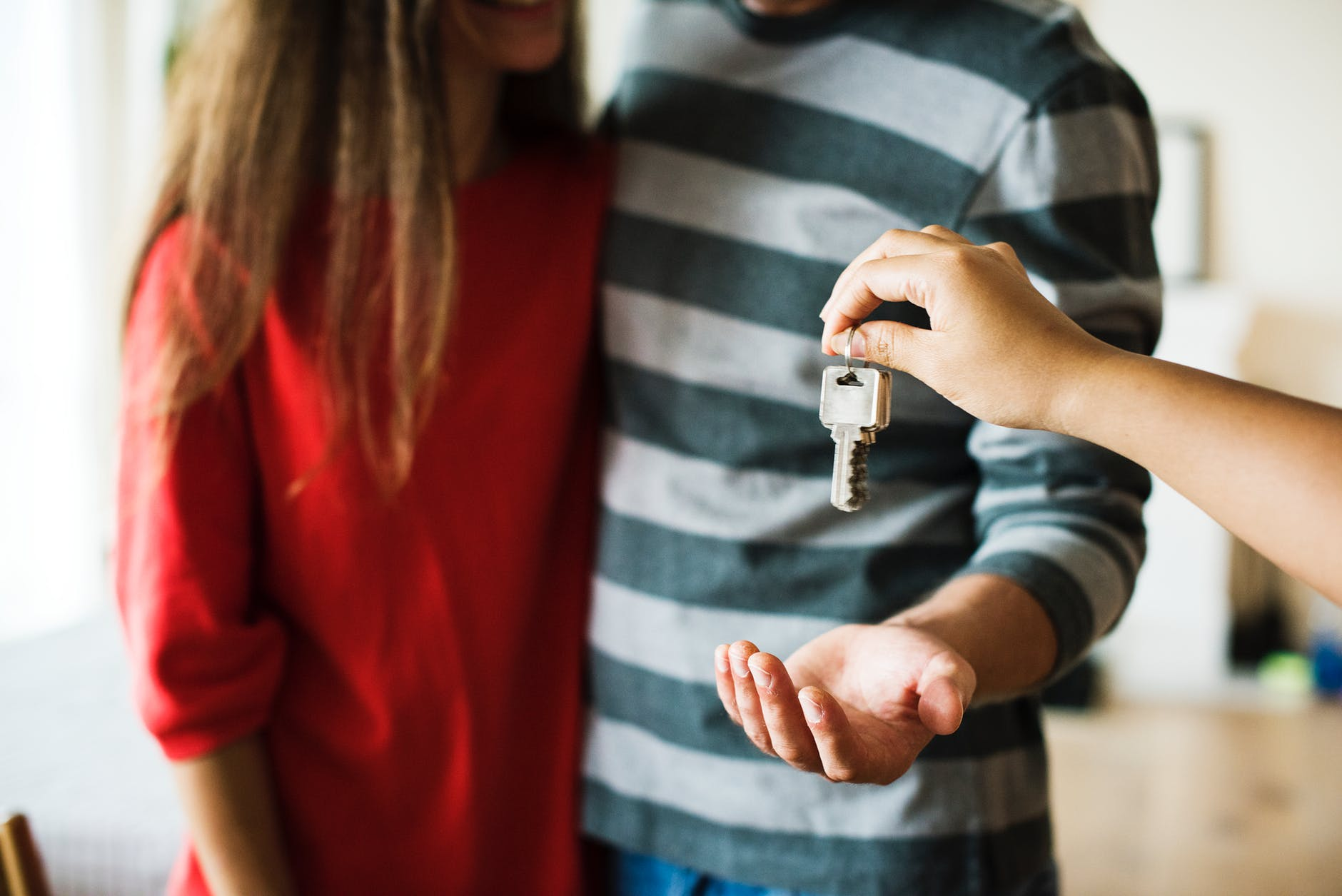 Individuals getting house keys-Before getting a home, they had to understand the reverse mortgage process.
