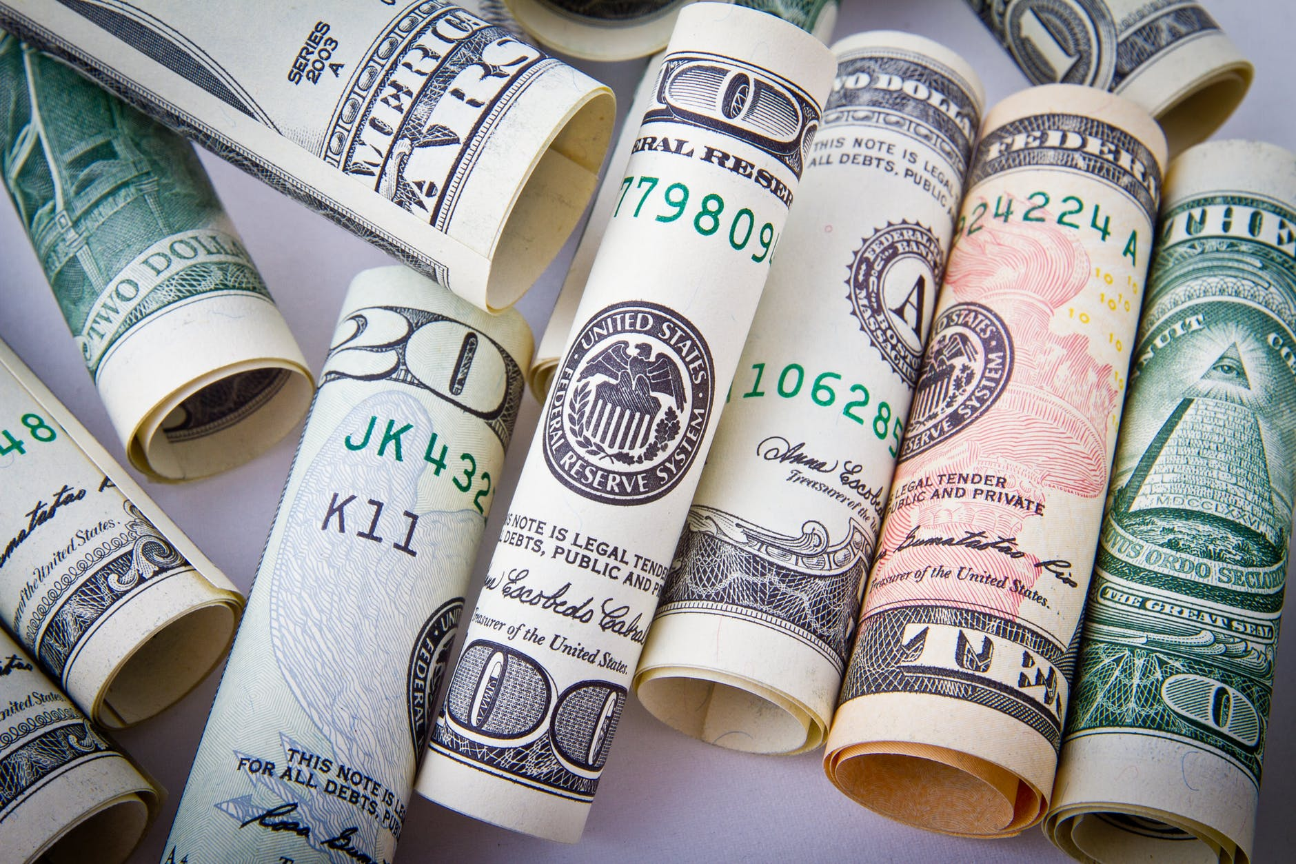 Money folded up in tight rolls: It is important to save money for long-term care.
