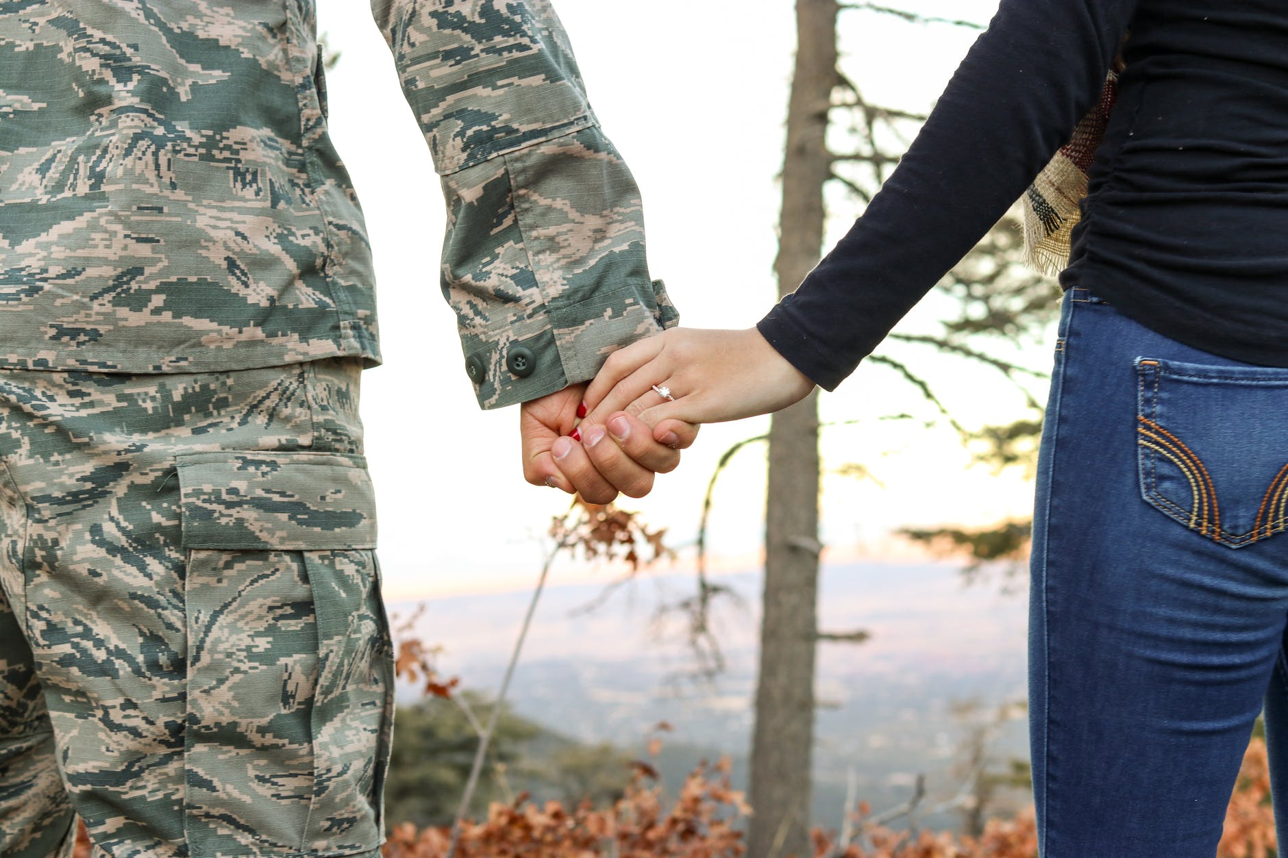 A veteran and his fiance holding hands. Even married veterans can experience veterans assisted living benefits.