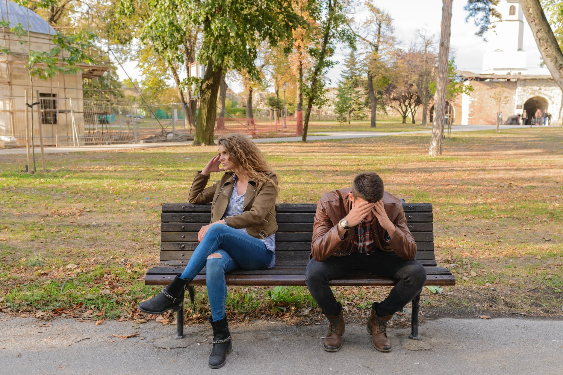 A young couple sitting on a bench-Sometimes it can be very tough to help a veteran with PTSD.