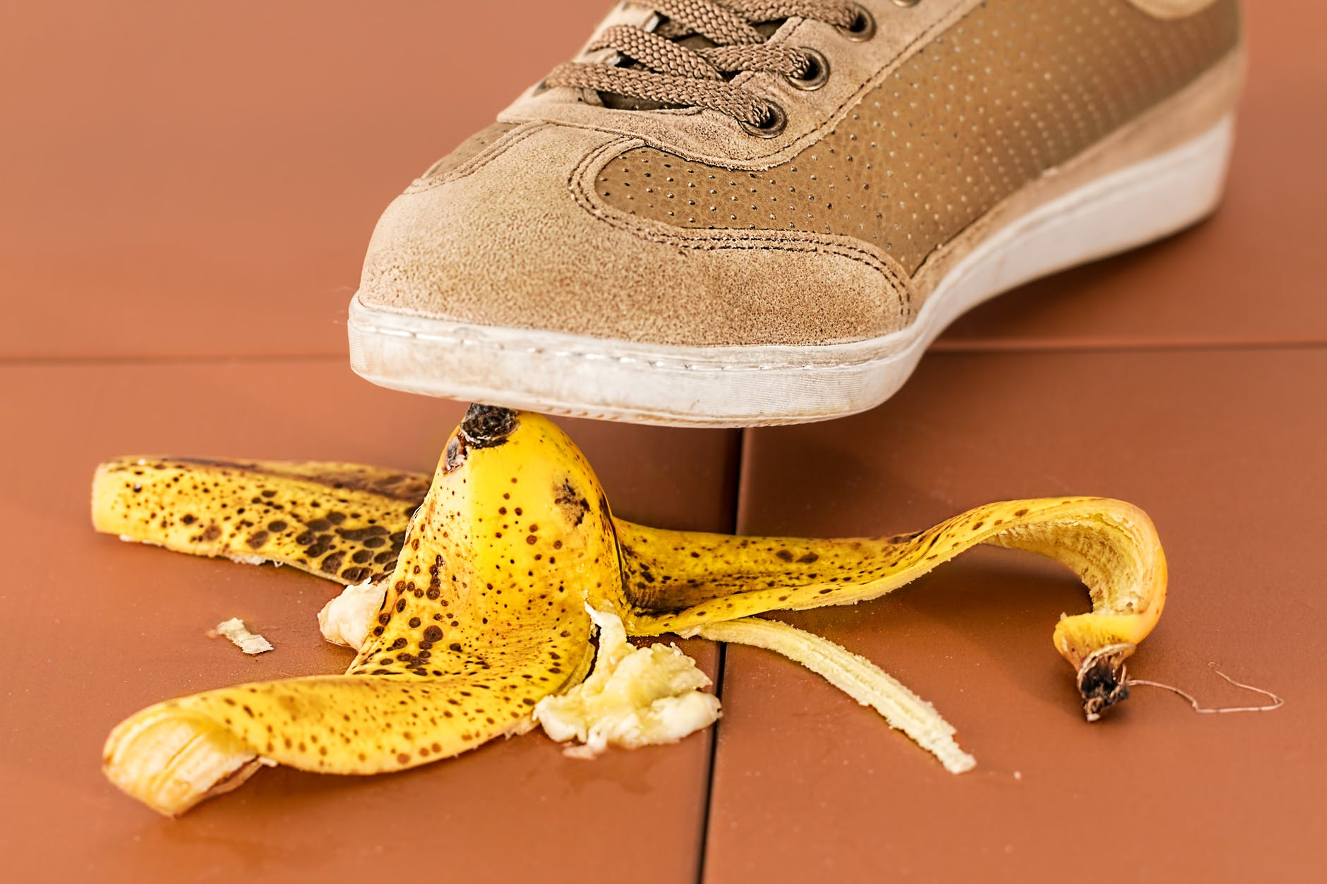 An individual about to step on a banana peel. The kitchen is an area of concern when determining if your home is safe for the seniors in your life.