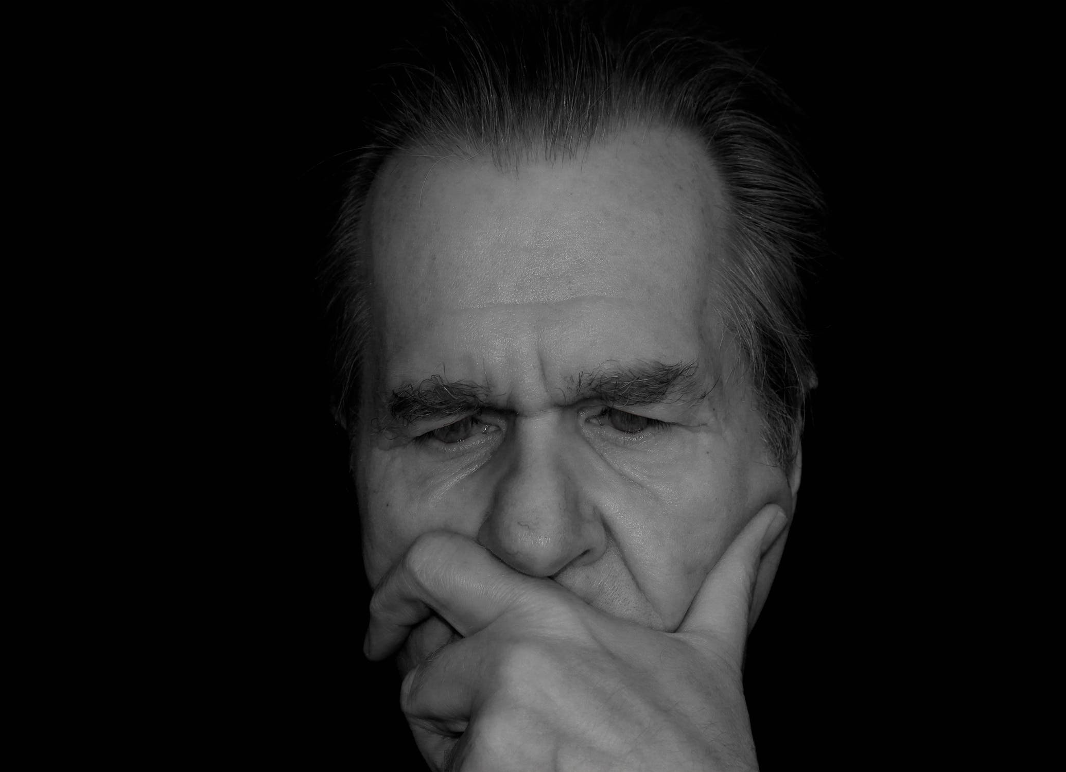 An older man thinking about if he is suffering from alzheimer's or forgetfulness.