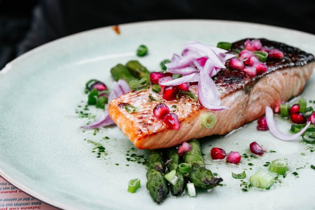 Salmon on a dinner plate. Salmon is a great heart healthy option.