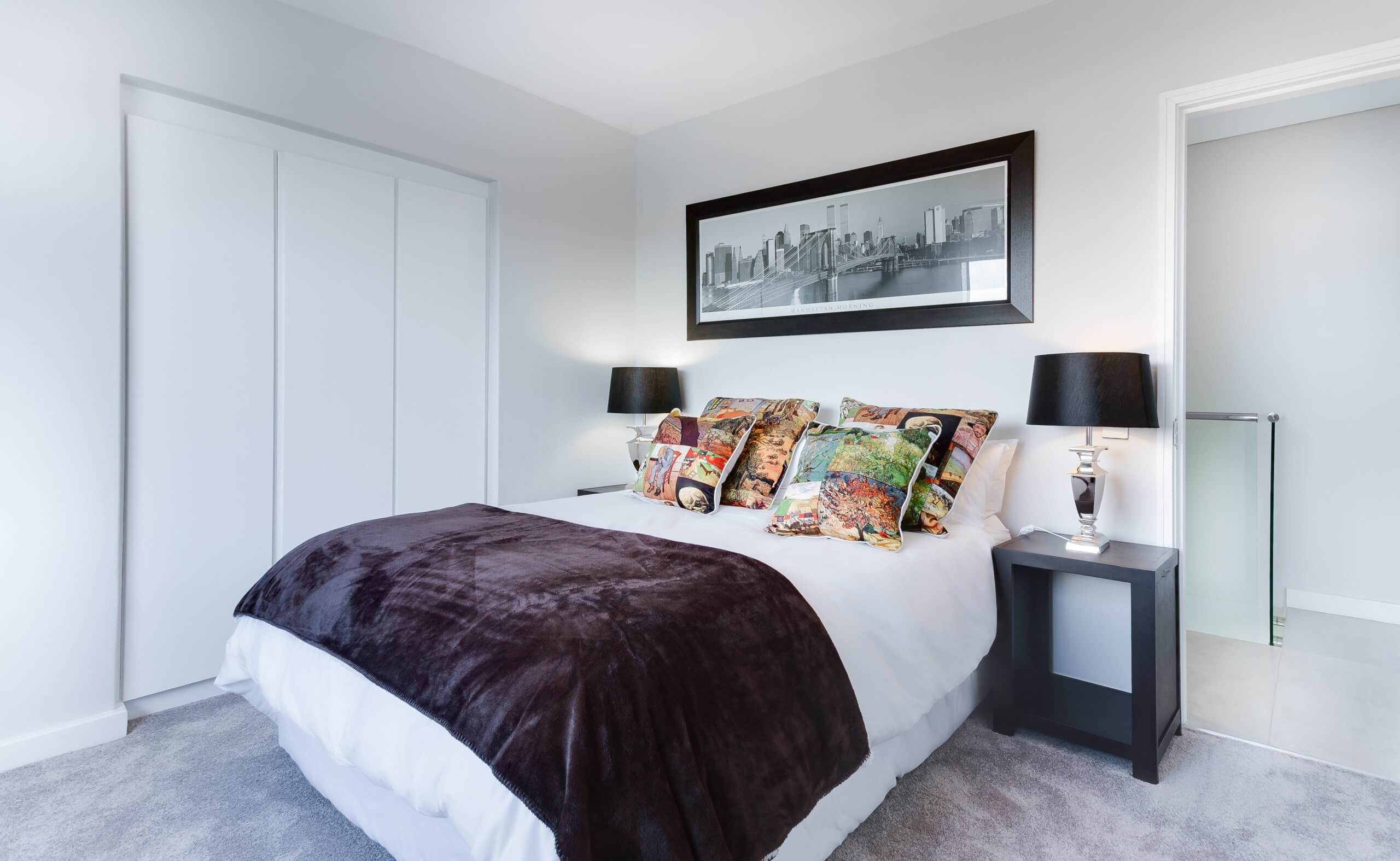A brand new mattress in a bedroom. Getting a new bed can help with better sleep.