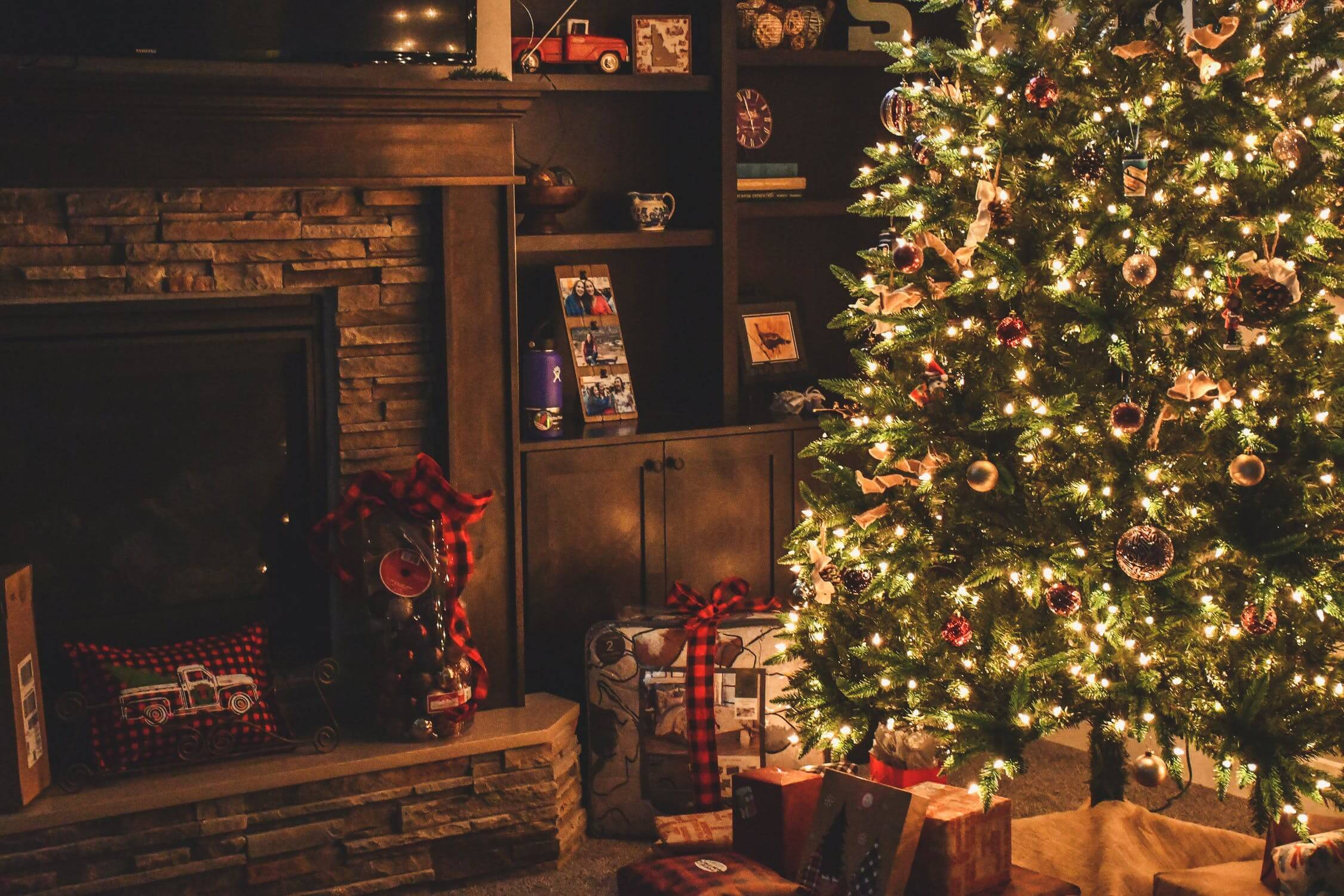 Presents under a Christmas tree. There are many holiday gifts for seniors that are great presents.