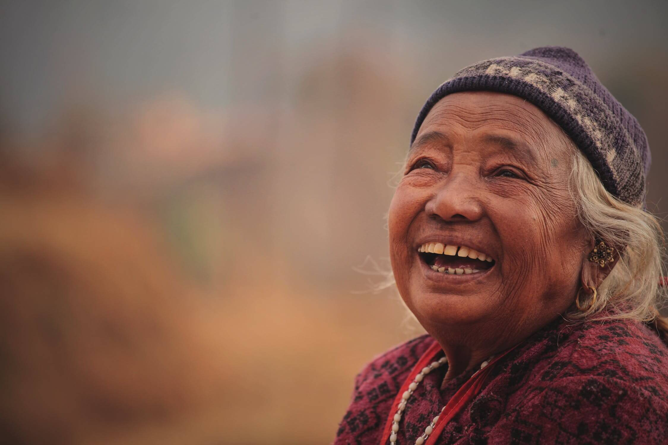 An older woman smiling thinking about senior living