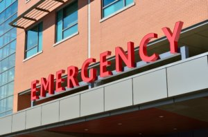 The outside of an emergency room. The reason seniors visit the ER varies.