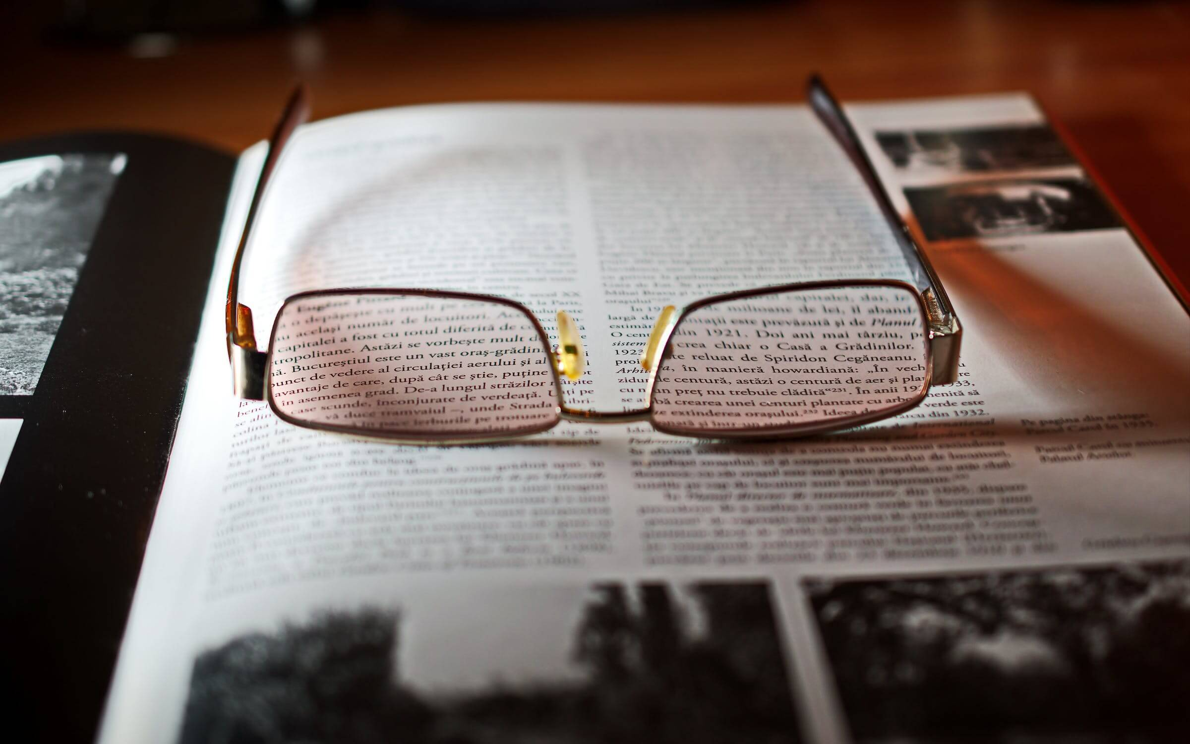 A pair of reading glasses on a book. Going to get health checkups is one of the healthy habits seniors can practice.
