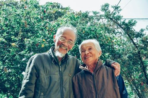 An older couple smiling because they are happy with the assisted living facility they choose to assist with their senior care.